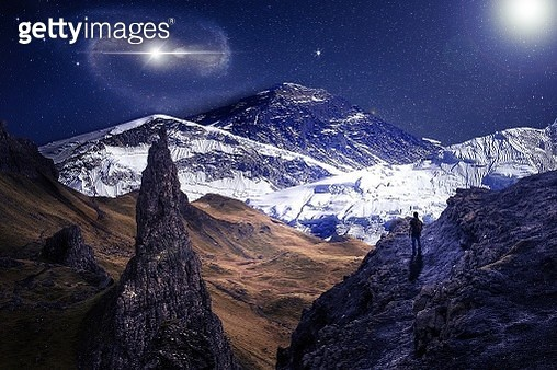 Scenic View Of Snowcapped Mountains Against Sky At Night - gettyimageskorea