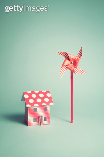 A paper home with red and white candy striped walls and a polka dot roof with it's own windmill/wind turbine - gettyimageskorea