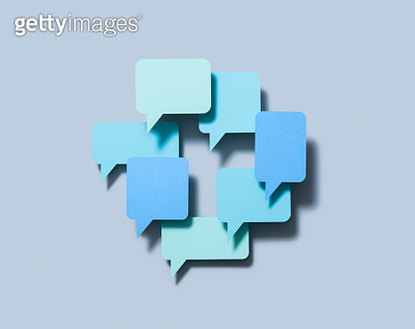 Various speech bubbles forming a ring (paper cutouts) - gettyimageskorea