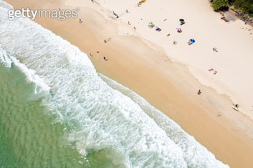 Aerial View of clean ocean waters with people on the beach and in the water, Burleigh Heads, Australia - gettyimageskorea