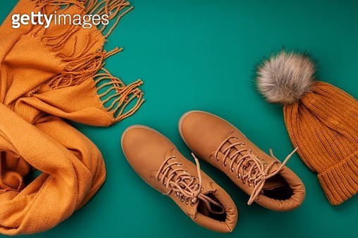 Directly Above Shot Of Shoes And Knit Hat By Scarf On Table - gettyimageskorea