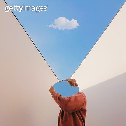 Person Holding Mirror Against Sky - gettyimageskorea