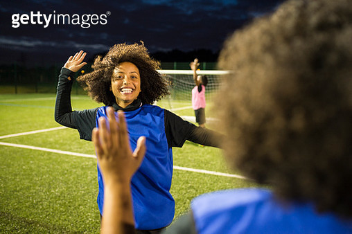 Female football players jubilant, Hackney, East London, UK - gettyimageskorea