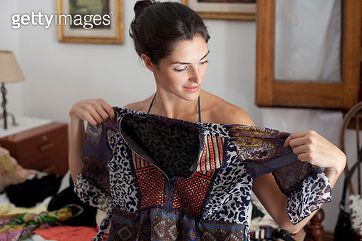 Woman deciding on her outfit - gettyimageskorea