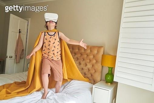 Child wearing blanket as a superhero cape - gettyimageskorea