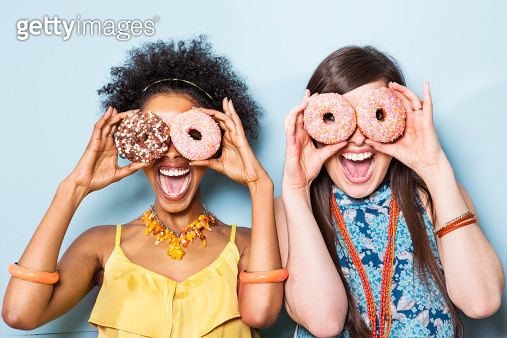 women holding doughnuts in front of eyes. - gettyimageskorea
