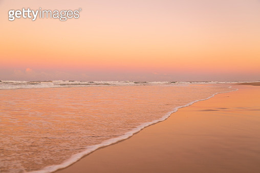 Vibrant Colored Sunrise over the ocean - gettyimageskorea