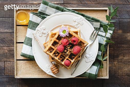 Belgian Waffles With Honey And Raspberries For Breakfast - gettyimageskorea