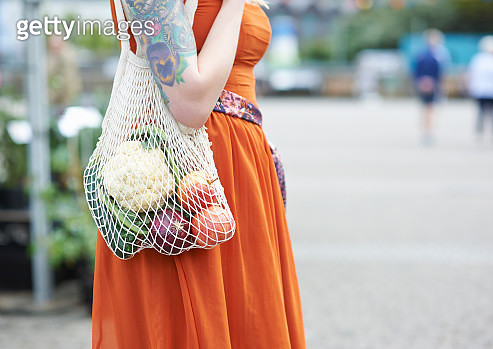 Hipster woman with reusable plastic free bag shopping for groceries, close up. - gettyimageskorea