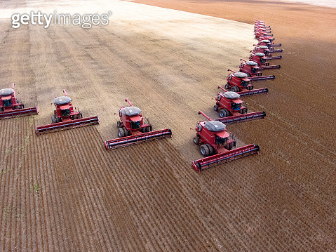 High Angle View Of Combine Harvesters On Field - gettyimageskorea