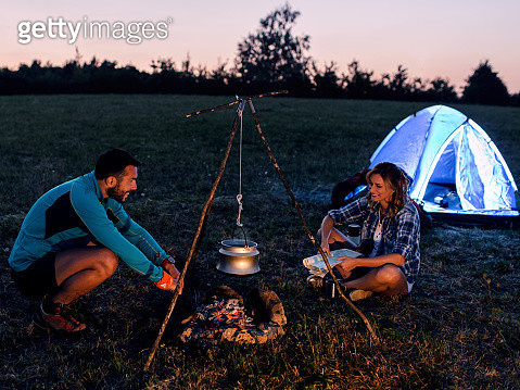Campers by the fire - gettyimageskorea