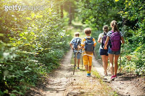 Family enjoying hiking together - gettyimageskorea