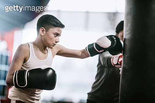 Young Man In Kickboxing Training Center - gettyimageskorea