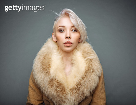 Portrait of model with blonde hair in fur coat - gettyimageskorea