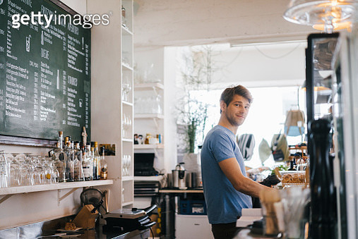 Portrait of smiling man in a cafe - gettyimageskorea