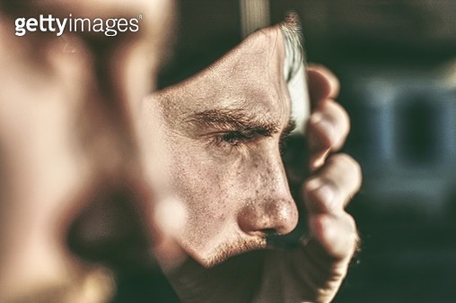 Close-Up Of Man Holding Broken Mirror Outdoors - gettyimageskorea