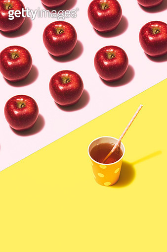Apple juice flat lay on yellow and pink background - gettyimageskorea