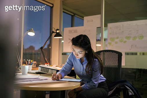 Businesswoman with digital tablet working late in office - gettyimageskorea