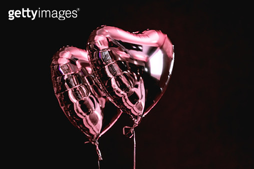 Close-Up Of Heart Shape Balloons Against Black Background - gettyimageskorea