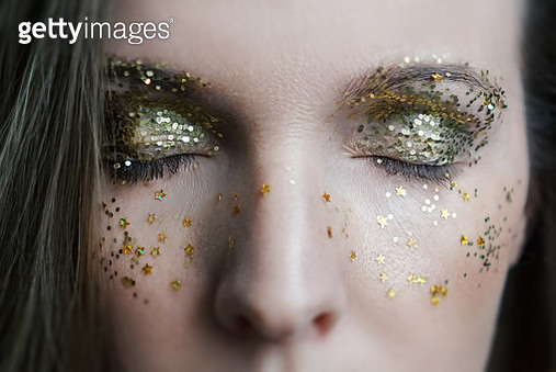 Festive makeup. Girl with sparkles on face. - gettyimageskorea