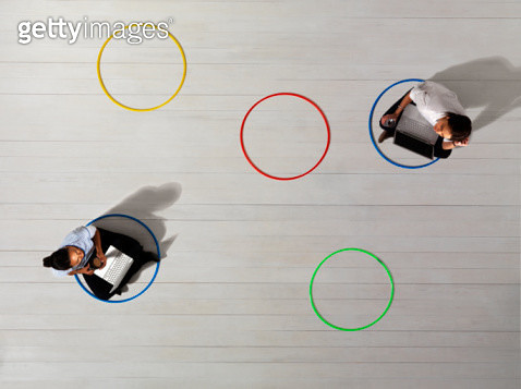 Business women in circles with laptops - gettyimageskorea