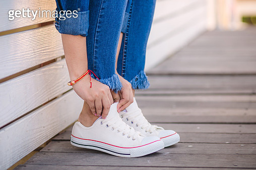 Close up of model in white sneakers - gettyimageskorea