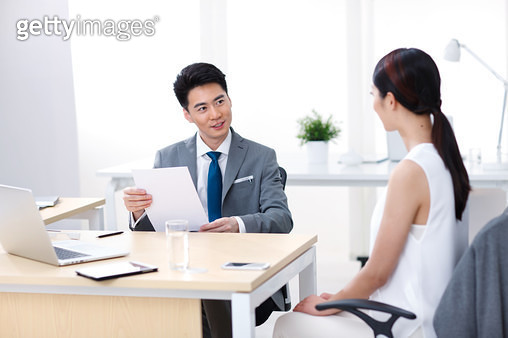 Happy young business people in the office work - gettyimageskorea