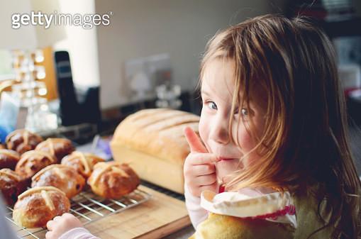 Little girl licking fingers at easter - gettyimageskorea