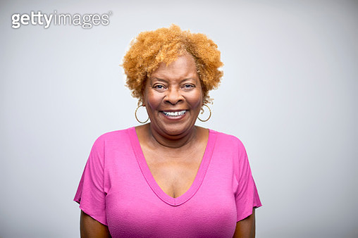 Portrait of cheerful female professional. Confident happy owner is wearing pink top. She is having frizzy hair. - gettyimageskorea