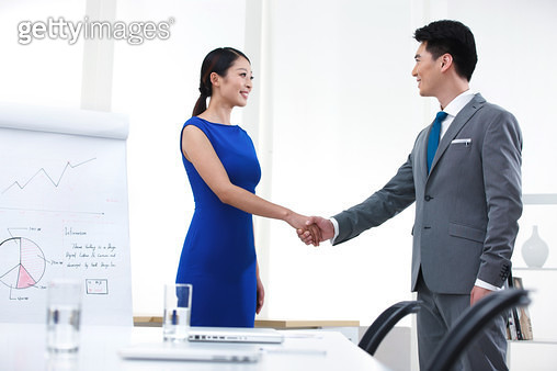 A young business people shake hands in the meeting room - gettyimageskorea
