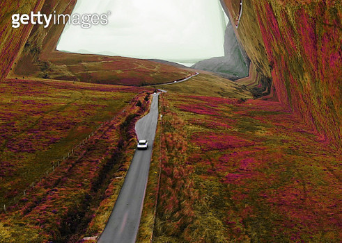 Surreal aerial view driving in Scotland bending the landscape with stunning colors creating tunnel effect. - gettyimageskorea