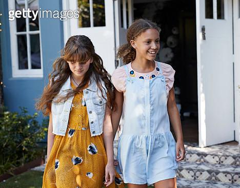 Girlfriends laughing together in garden - gettyimageskorea