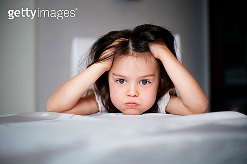 Frustrated Caucasian girl laying on bed - gettyimageskorea