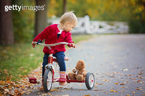Cute little baby girl, riding a tricycle in an autumn park, cute blond toddler girl - gettyimageskorea