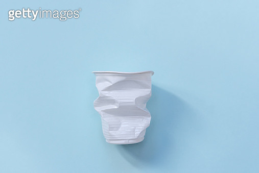 Plastic utensils. Social environmental problem. Plastic pollution of the planet. White plastic on a blue background. Environmental disaster. Sorting and processing of sticks. - gettyimageskorea