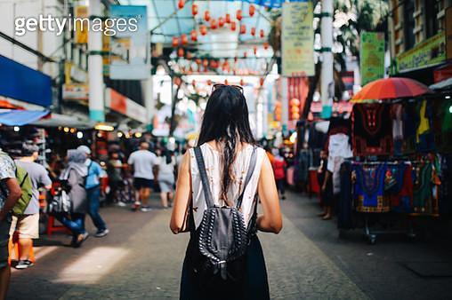 Young traveler woman in Kuala Lumpur Chinatown district - gettyimageskorea