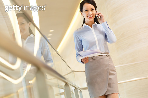 Successful business woman make a phone call - gettyimageskorea