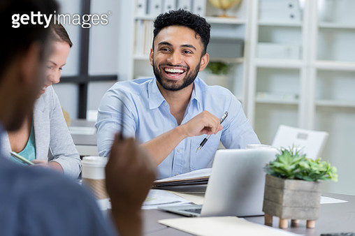 Businessman laughs while meeting with colleagues - gettyimageskorea