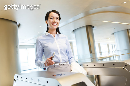 Successful business women use mobile phone card - gettyimageskorea