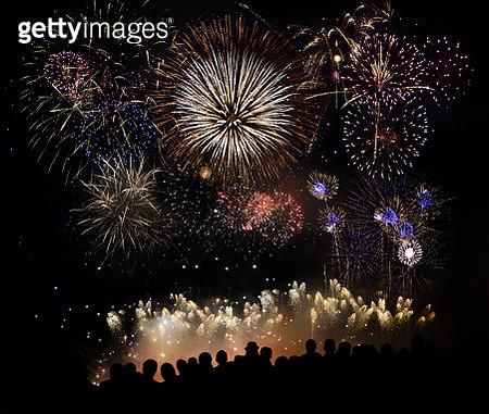 People Watching Beautiful Fireworks - gettyimageskorea