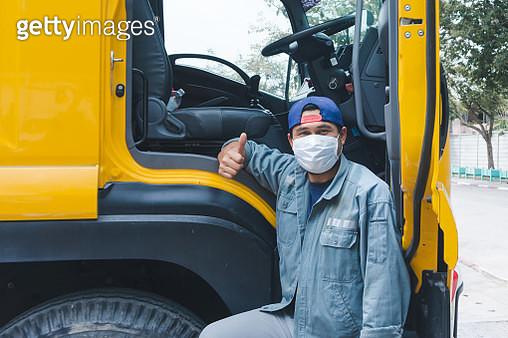 Portrait Of Man Wearing Mask Standing By Truck - gettyimageskorea