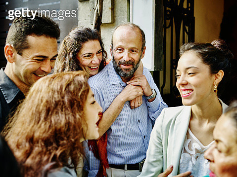 Family talking and laughing during party - gettyimageskorea