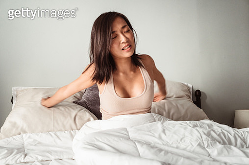 woman waking up in the bed - gettyimageskorea