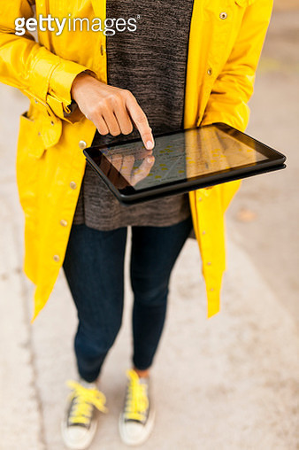 Close-up of woman using tablet with digital street map - gettyimageskorea