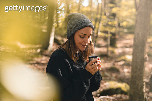 Woman picking mushrooms and drinking coffee in the forest - gettyimageskorea