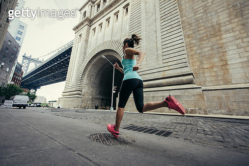 Young female runner running in Brooklyn, New York, USA - gettyimageskorea