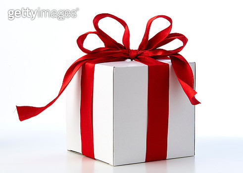 Close-Up Of Christmas Present Against White Background - gettyimageskorea