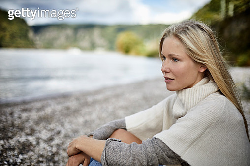 Blond young woman at the riverbank - gettyimageskorea