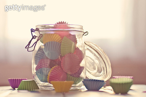 Colorful cupcakes cups in  a cooking jar - gettyimageskorea