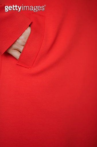 Woman hand in the pocket of the red jacket or coat. Nicely fits for book cover - gettyimageskorea